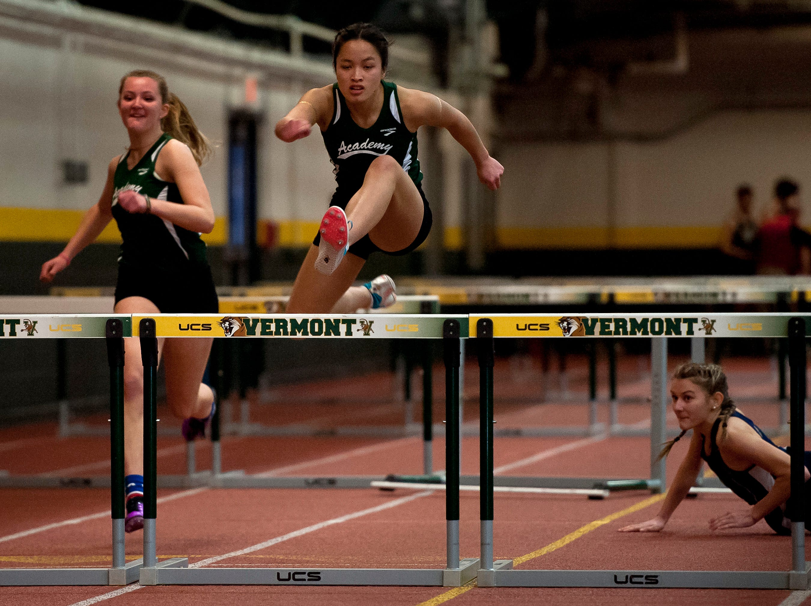 St. Johnsbury's Jen Rotti, center, clears the final hurdle in to win the girls 55-meter hurdles at the high school indoor track state championships at the University of Vermont on Saturday.