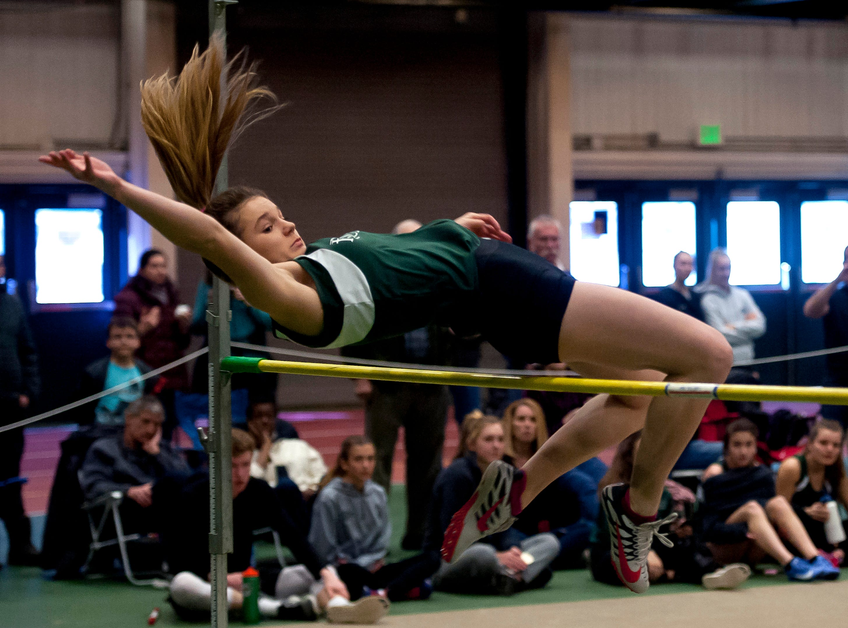 Rice's Cathryn Senesac attempts the high jump at the high school indoor track state championships at the University of Vermont on Saturday.