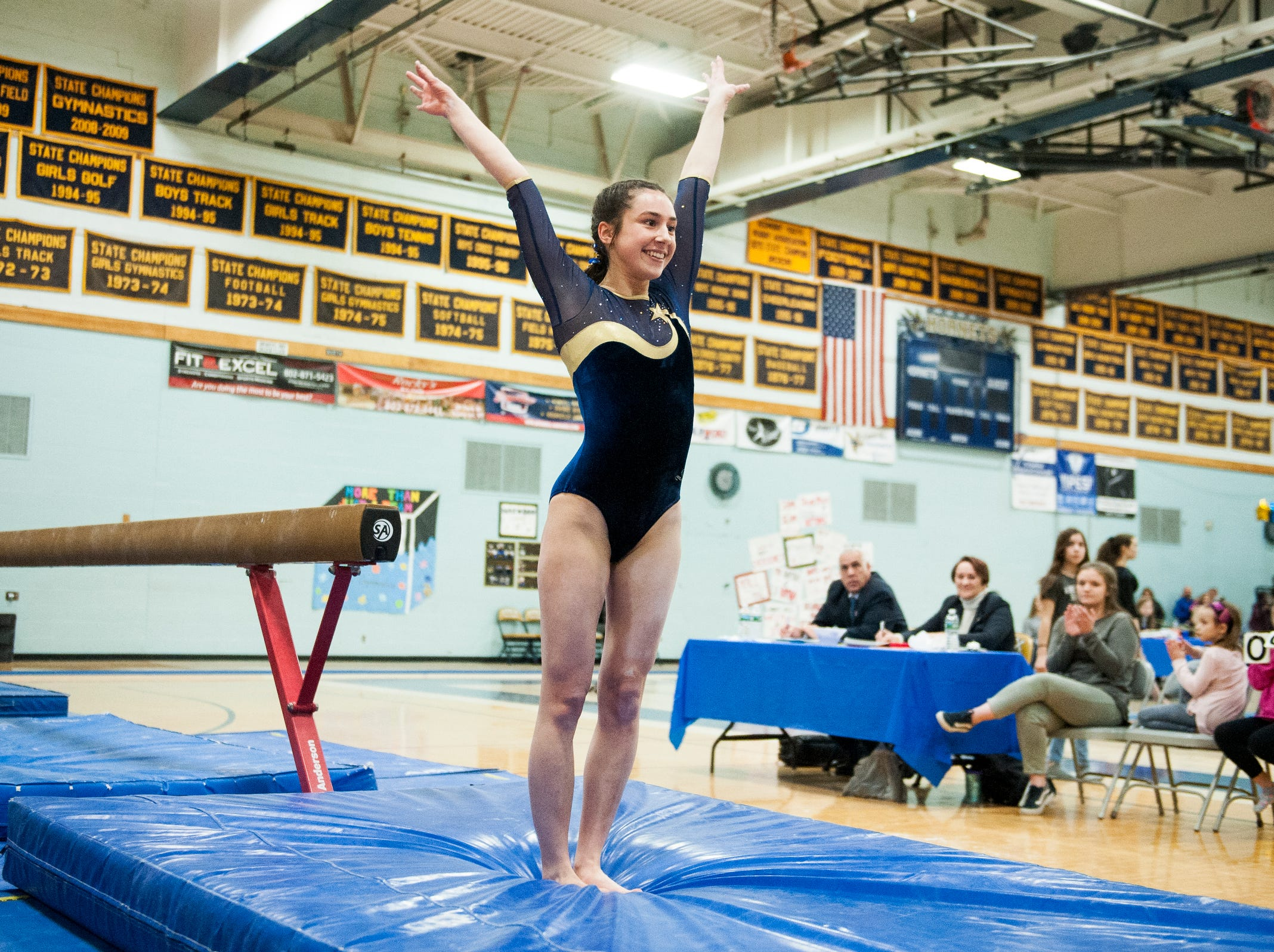 Essex's Ella Lesny lands her dismount on the bars routine during the 2019 high school gymnastics championship at Essex High School on Saturday afternoon February 16, 2019 in Essex, Vermont.
