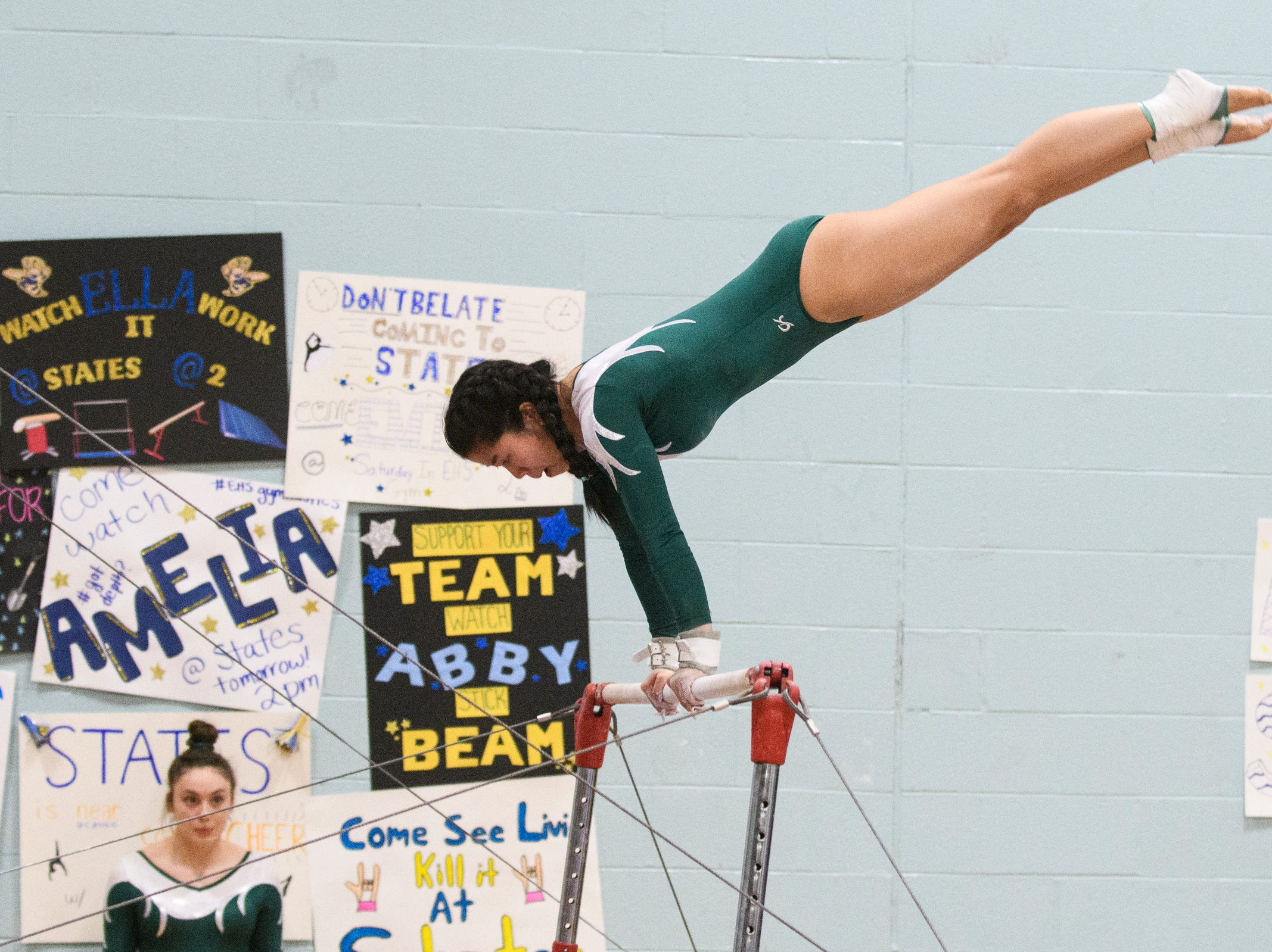 St. Johnsbury's Emma Stelzner competes in the bar routine during the 2019 high school gymnastics championship at Essex High School on Saturday afternoon February 16, 2019 in Essex, Vermont.