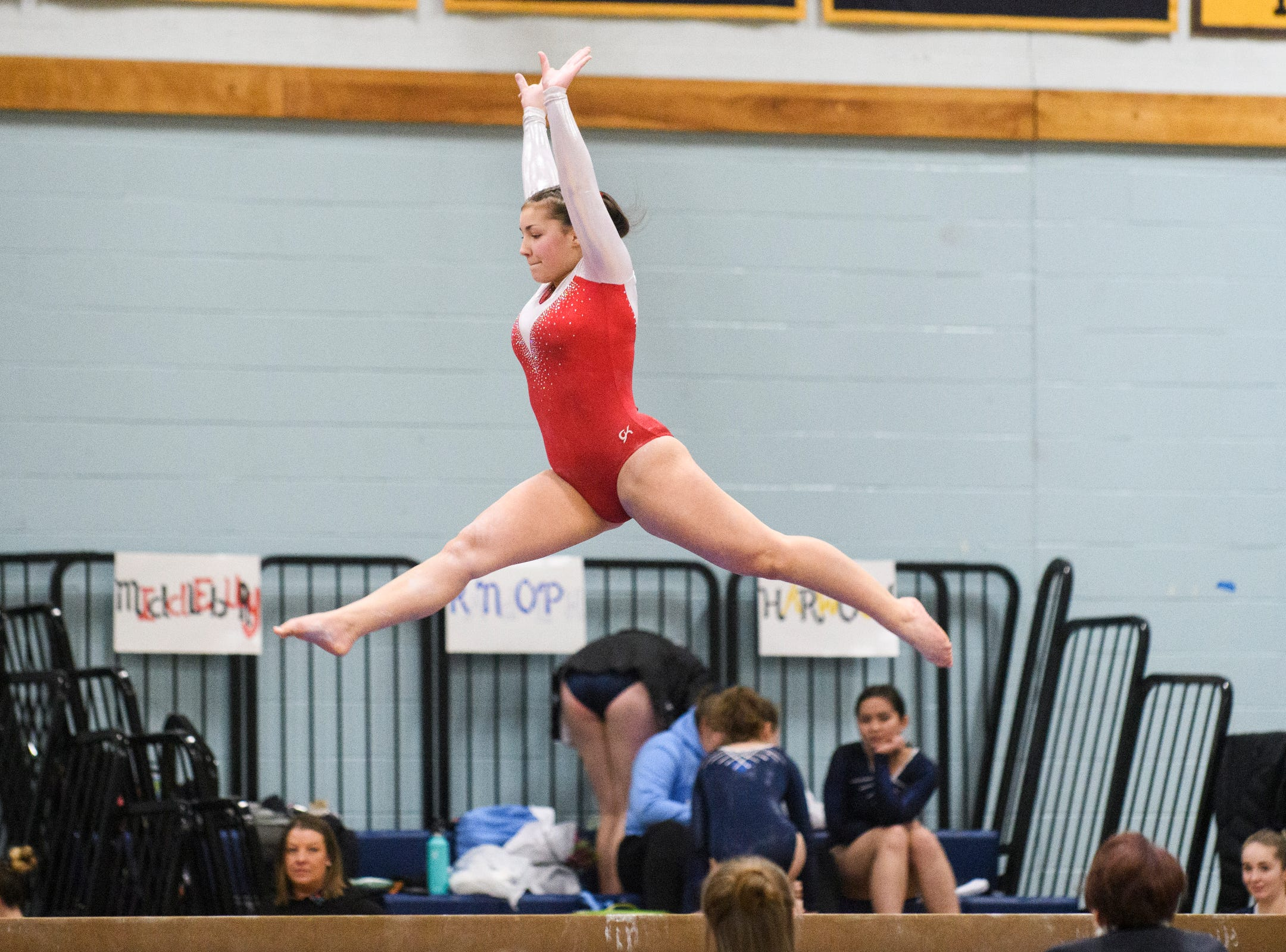 CVU's Logan Claffy competes in the bar during the 2019 high school gymnastics championship at Essex High School on Saturday afternoon February 16, 2019 in Essex, Vermont.
