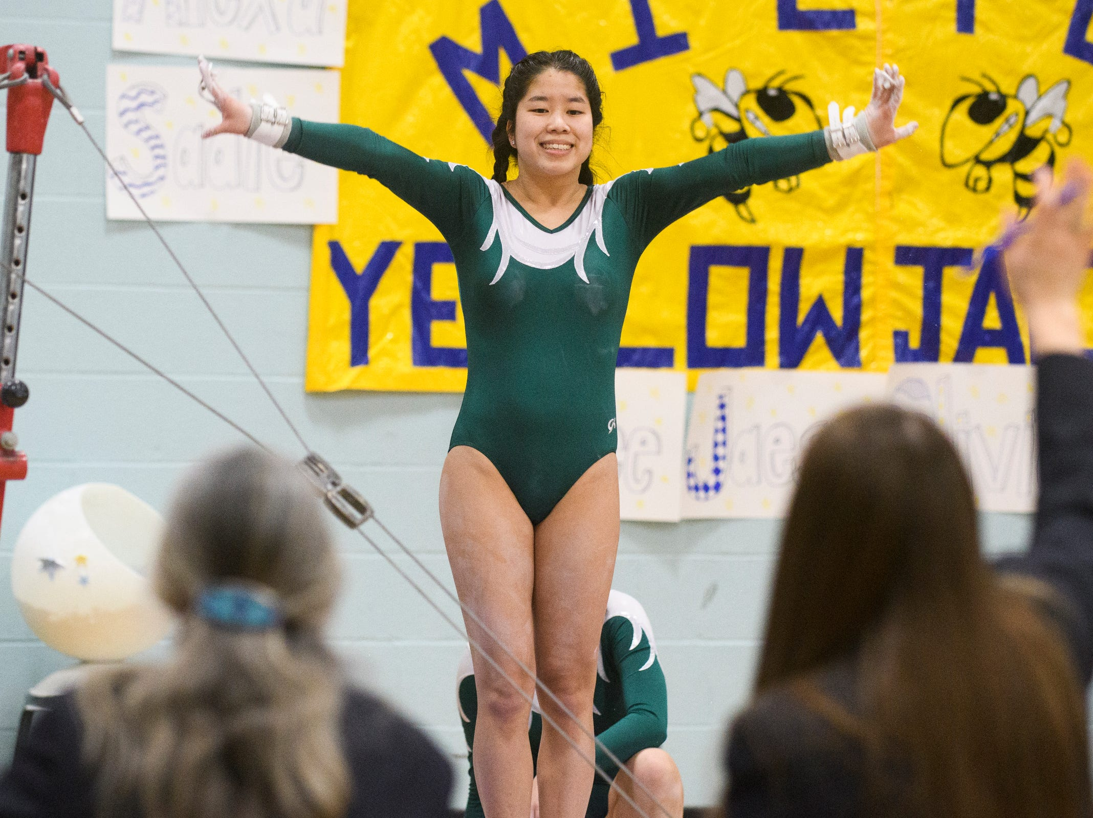 St. Johnsbury's Emma Stelzner signals to the judges that she's ready to compete in the bars during the 2019 high school gymnastics championship at Essex High School on Saturday afternoon February 16, 2019 in Essex, Vermont.