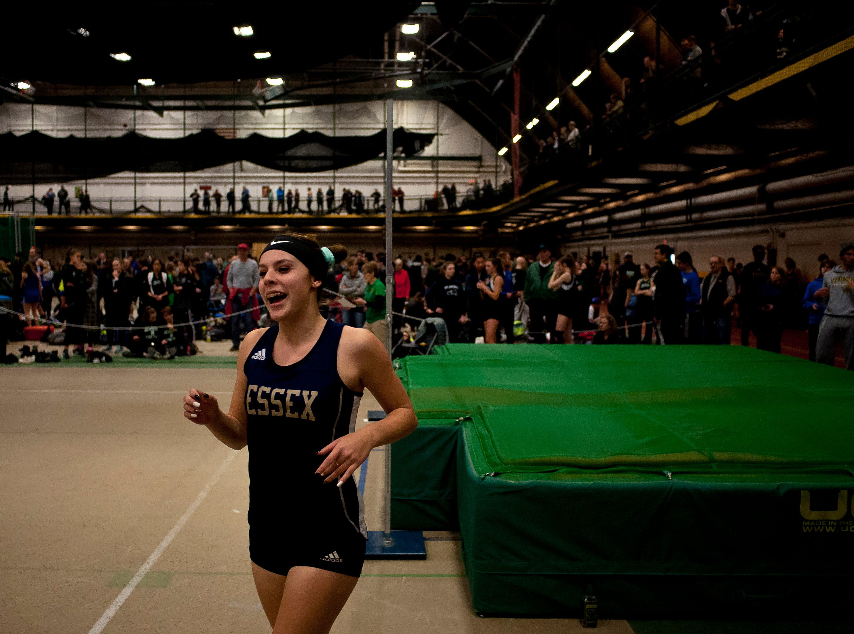 Essex's Hannah Neddo reacts after a successful high jump attempt at the high school indoor track state championships at the University of Vermont on Saturday.