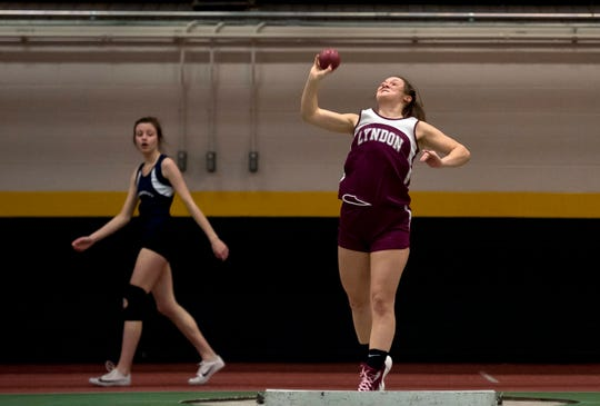 Lyndon's Camryn Heath , right, heaves the shot put at the high school indoor track state championships at the University of Vermont this past winter.