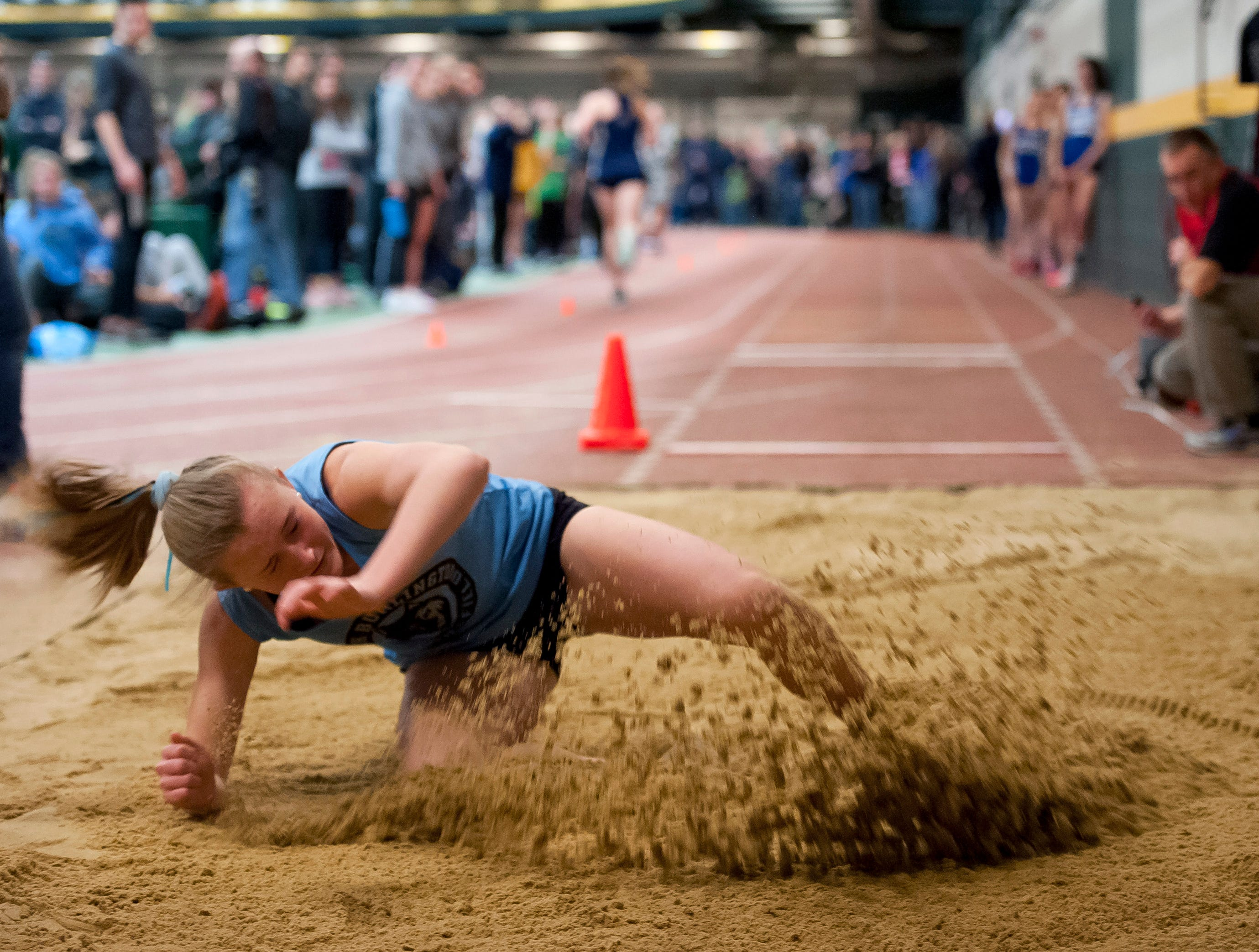 South Burlington's Odessa O'Brien reacts after landing a long jump attempt at the high school indoor track state championships at the University of Vermont on Saturday.