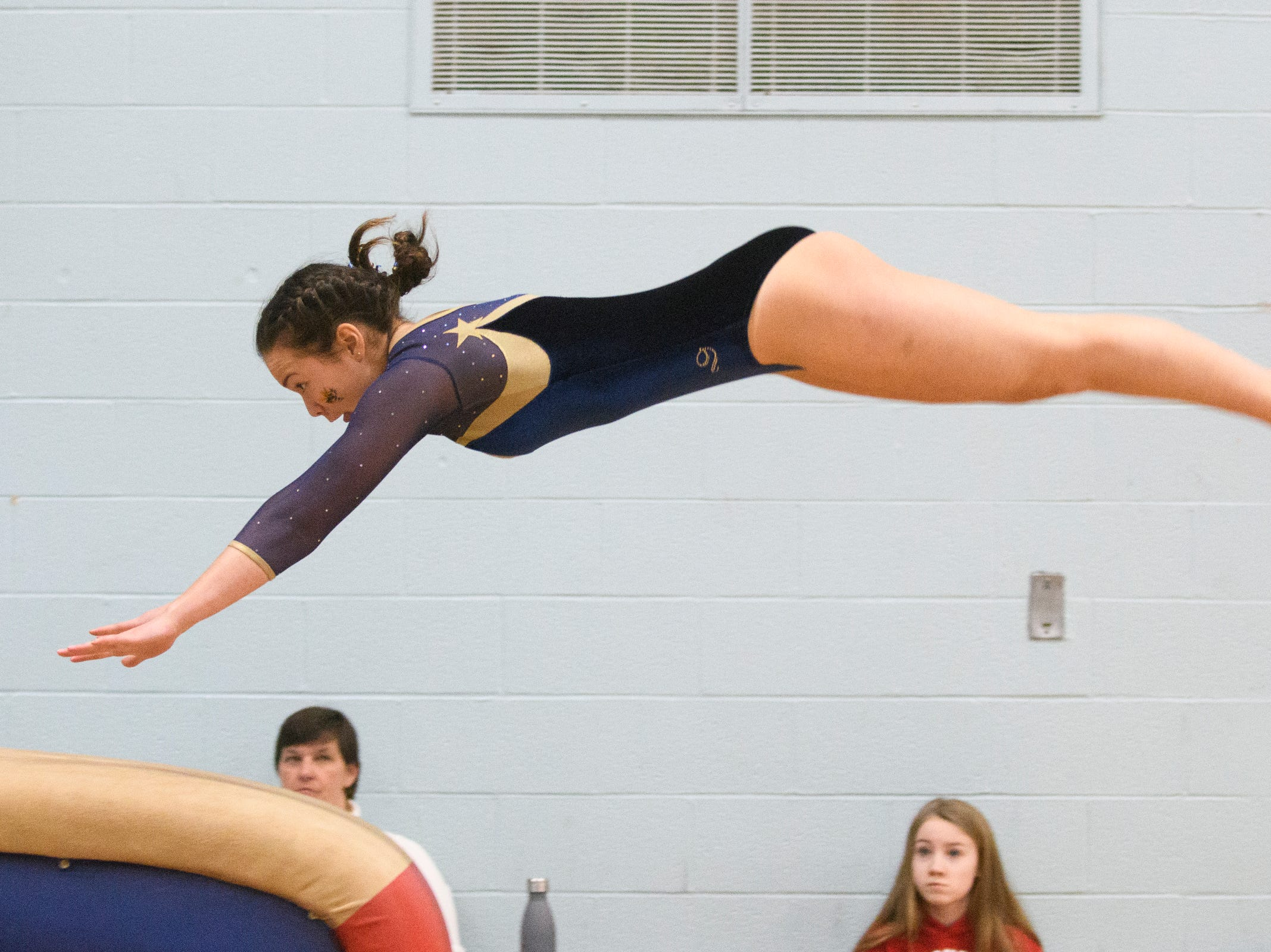Essex's Gabriela Schmida competes in the vault during the 2019 high school gymnastics championship at Essex High School on Saturday afternoon February 16, 2019 in Essex, Vermont.