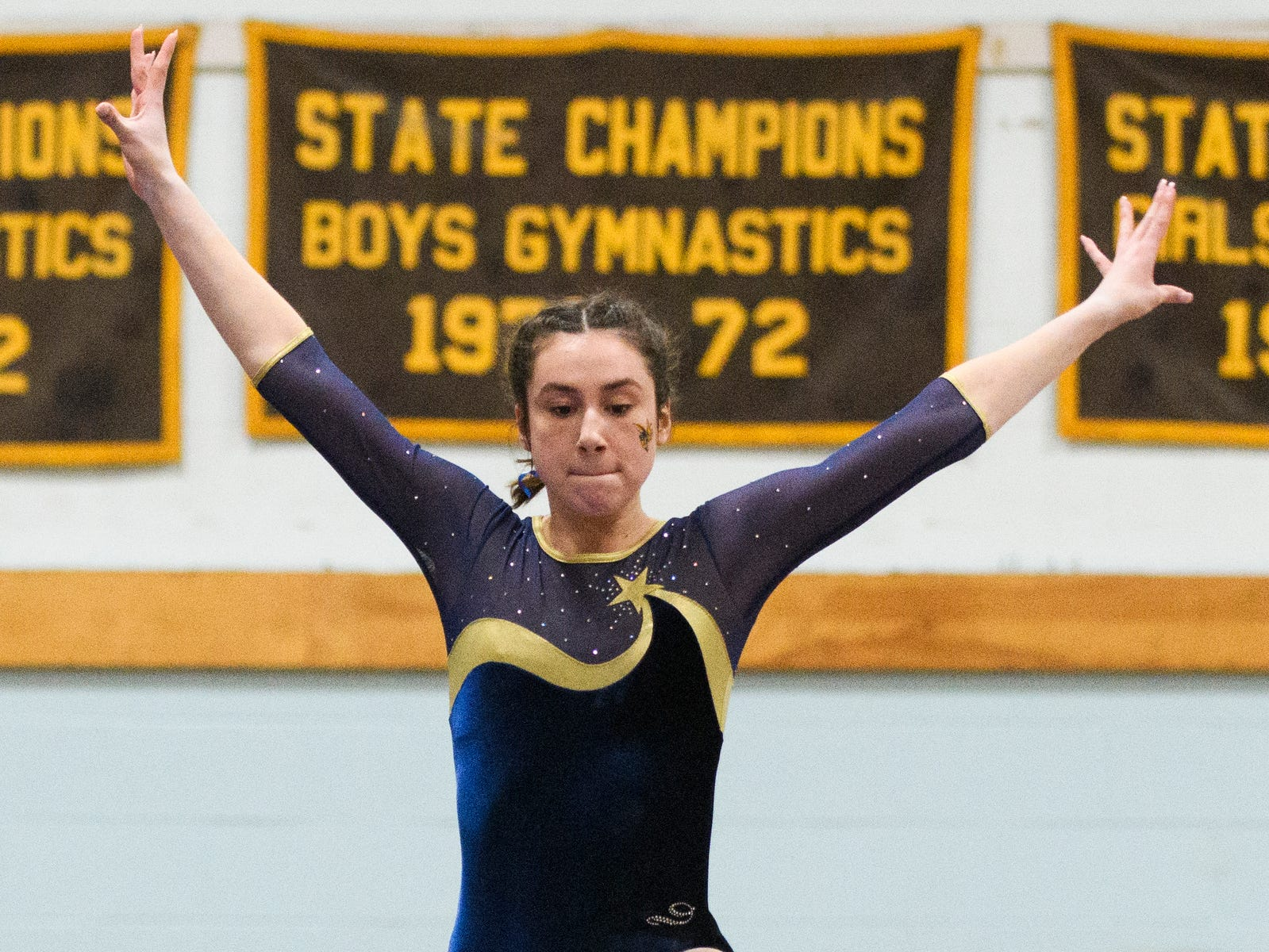 Essex's Ella Lesny competes in the bars during the 2019 high school gymnastics championship at Essex High School on Saturday afternoon February 16, 2019 in Essex, Vermont.