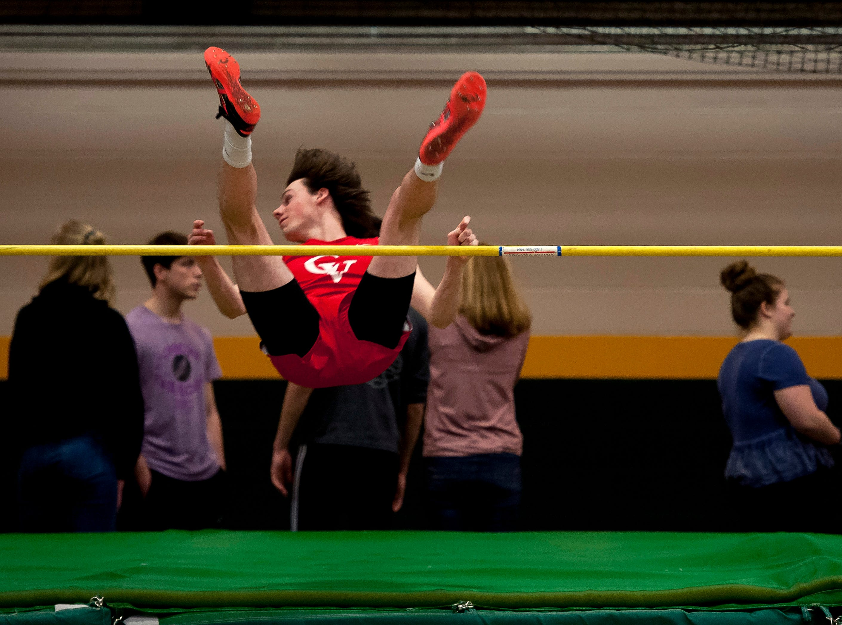 Champlain Valley's Seamus Higgins clears the bar in the high jump at the high school indoor track state championships at the University of Vermont on Saturday.