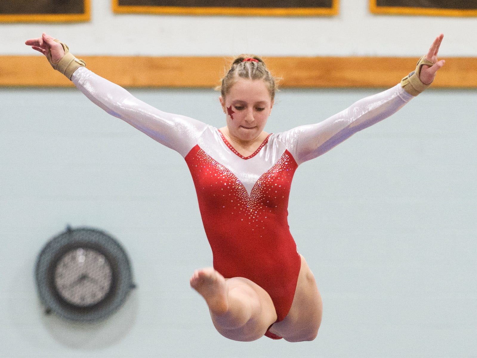 CVU's Laurynn Bombardier compels in the bar during the 2019 high school gymnastics championship at Essex High School on Saturday afternoon February 16, 2019 in Essex, Vermont.