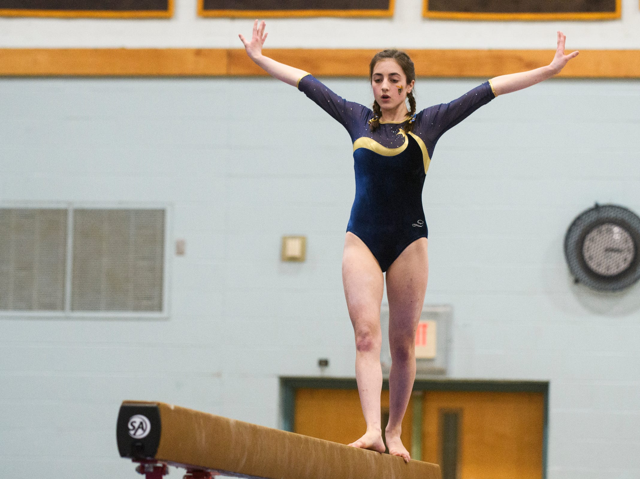 Essex's Livia Ball compete in the bar during the 2019 high school gymnastics championship at Essex High School on Saturday afternoon February 16, 2019 in Essex, Vermont. (