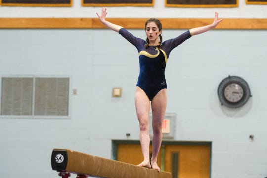 Essex's Livia Ball compete in the bars during the 2019 high school gymnastics championship at Essex High School on Saturday afternoon February 16, 2019 in Essex, Vermont.