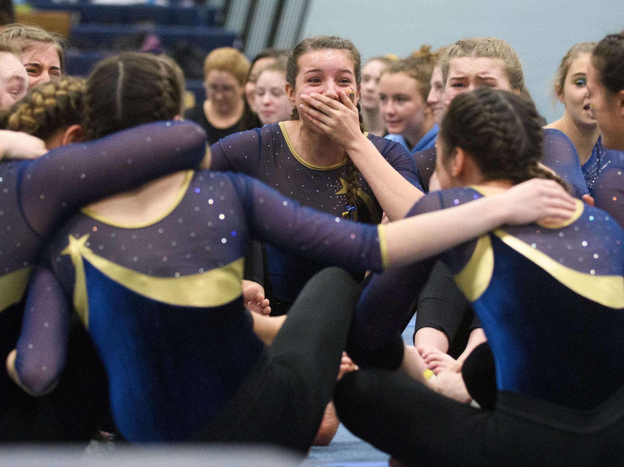 Essex reacts to the announcement of the state championship during the 2019 high school gymnastics championship at Essex High School on Saturday afternoon February 16, 2019 in Essex, Vermont.