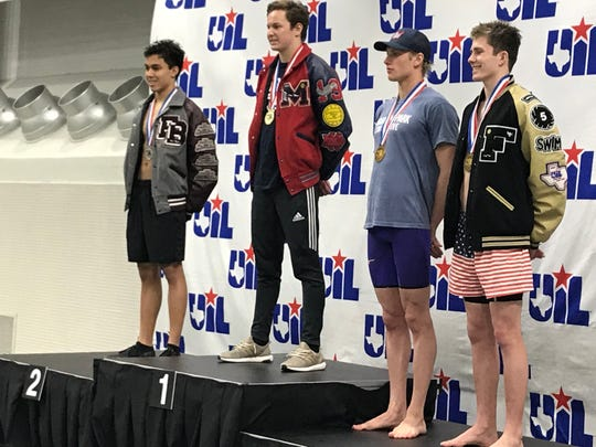 Flour Bluff senior Alex Wallett wears his silver medal after finishing second in the Class 5A boys 50-yard freestyle at the UIL State Swiming and Diving Championships in Austin on February 16, 2019.