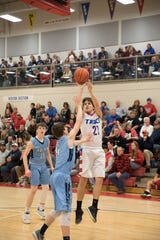 Zane Trace's Trey Miller takes a jumps shot against Adena during a junior varsity game last year at Zane Trace High School.