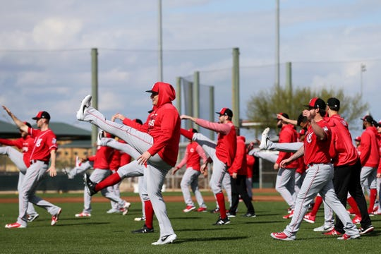 Cincinnati Reds pitchers stretch, Sunday, Feb. 17, 2019, at the Cincinnati Reds spring training facility in Goodyear, Arizona.