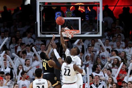 Wichita State Shockers guard Samajae Haynes-Jones (4) drives to the basket against Cincinnati Bearcats forward Eliel Nsoseme (22) and forward Trevon Scott (13) in the first half at Fifth Third Arena.