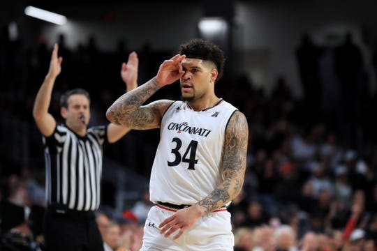 Cincinnati Bearcats guard Jarron Cumberland (34) reacts after scoring against the Wichita State Shockers in the first half at Fifth Third Arena.
