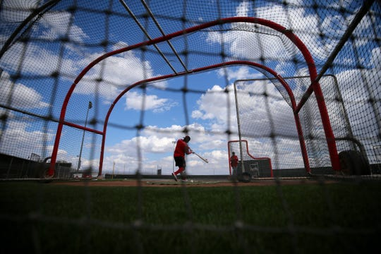 Cincinnati Reds right fielder Yasiel Puig (66) works individually as position players officially reported to camp, Sunday, Feb. 17, 2019, at the Cincinnati Reds spring training facility in Goodyear, Arizona.