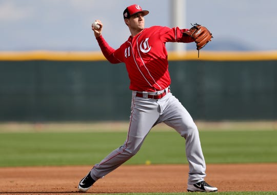 Cincinnati Reds pitcher Matt Wisler (41) throws to first base during fielding drills, Sunday, Feb. 17, 2019, at the Cincinnati Reds spring training facility in Goodyear, Arizona.