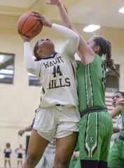Kennedi Myles shoots the ball against Seton in the OHSAA Sectional at Sycamore High School, Saturday Feb. 16, 2019