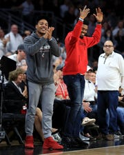 Orlando Magic guard Troy Caupain (left) and Golden State Warriors guard Jacob Evans (right) cheer from the sidelines during the game between the Wichita State Shockers and the Cincinnati Bearcats at Fifth Third Arena. Mandatory Credit: Aaron Doster-USA TODAY Sports