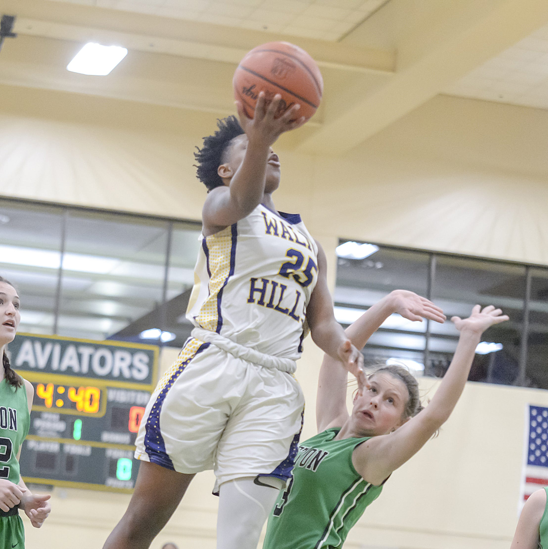 Darian Burgin of Walnut Hills lays up the ball against Seton in the OHSAA Sectional at Sycamore High School, Saturday Feb. 16, 2019