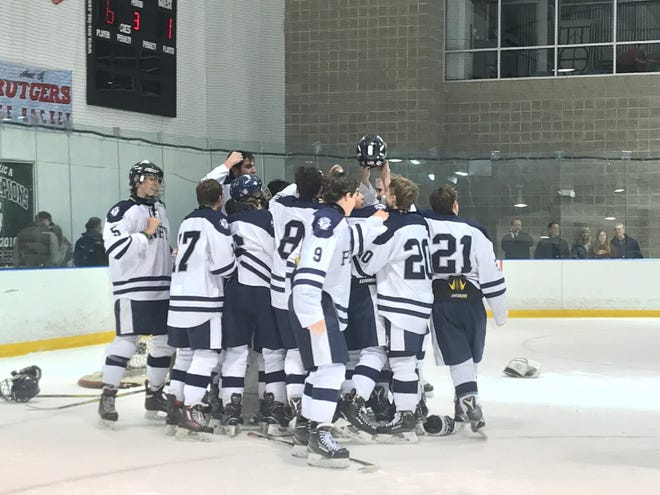 The Pingry ice hockey team celebrates winning the Skyland Conference Tournament title with a 6-1 win over Hillsborough on Saturday, Feb. 16, 2019.