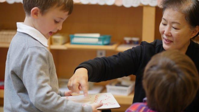Cole Klemme of Peapack and Willow kindergarten teacher Julie Kim of Bridgewater.