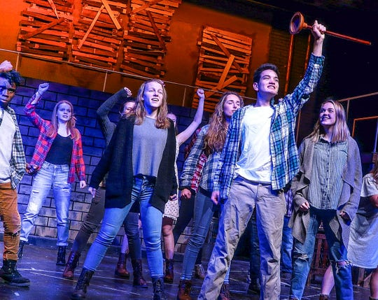 """Thai Branowski holds his toilet plunger aloft to signify rebellion in Delaware Valley Regional High School's production of """"Urinetown,"""" which will be presented Feb. 28 to March 2."""