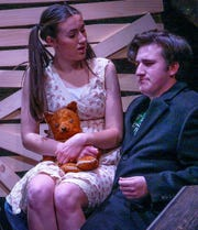 """A street urchin played by Keilah Hanley exchanges views with a police officer, portrayed by Will Pearce, in Delaware Valley Regional High School's production of """"Urinetown,"""" which will be presented Feb. 28 to March 2."""