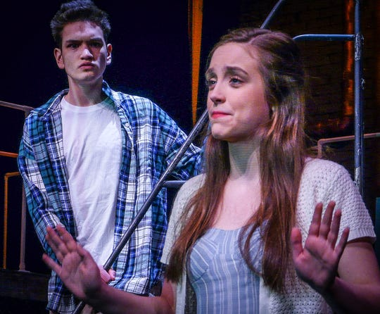 """Ashley Henderson plays the daughter of an evil oligarch. She falls in love with one of his employees, played by Thai Branowski, in Delaware Valley Regional High School's production of """"Urinetown."""" The show goes on Feb. 28 to March 2."""