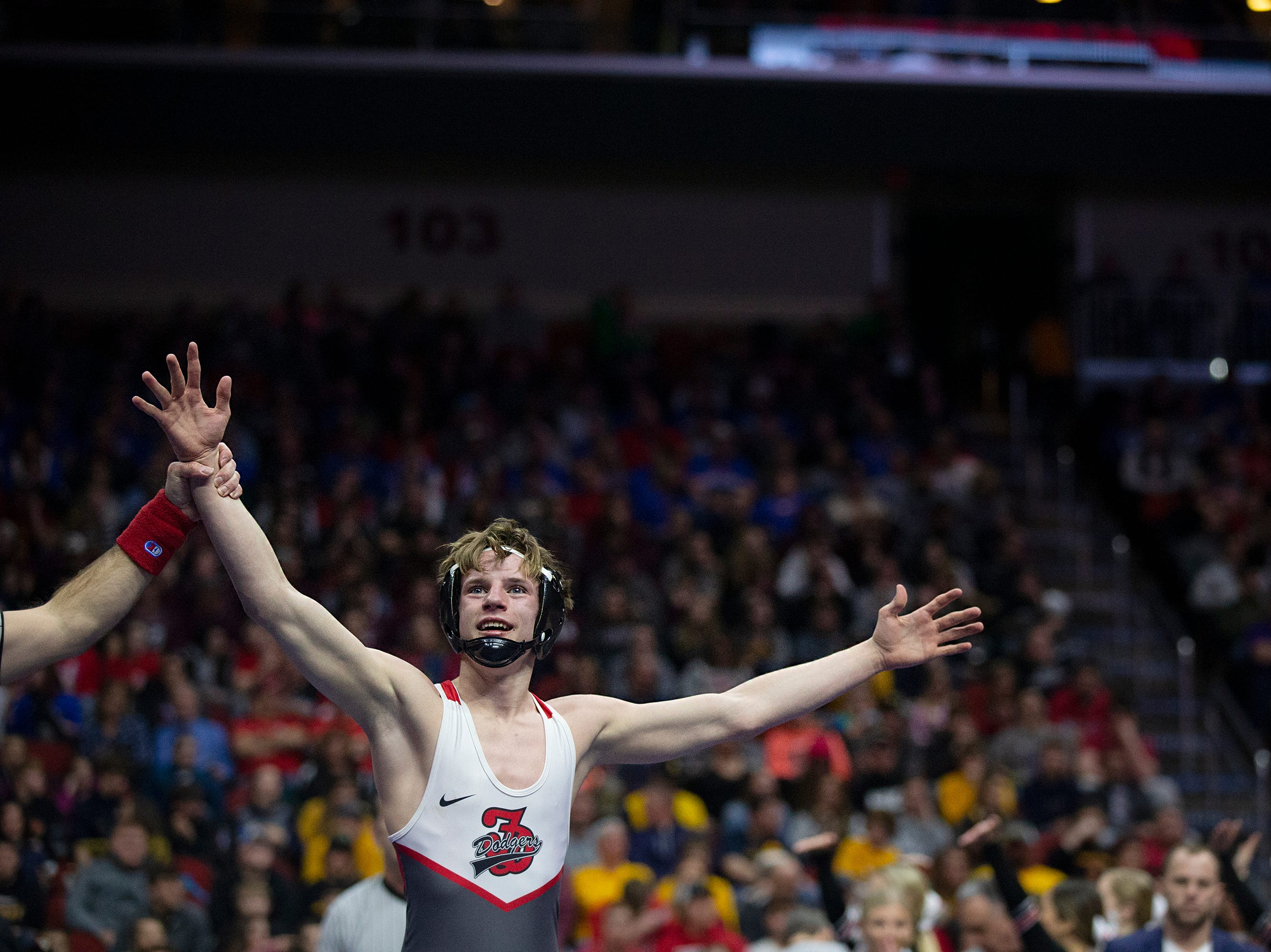 Fort Dodge's Carson Taylor wins the 120 pound Class 3A championship match against Iowa City West's Hunter Garvin during the Iowa high school state wrestling tournament on Saturday, Feb. 16, 2019, in Wells Fargo Arena.