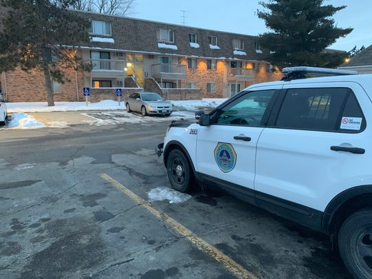 A Des Moines police cruiser parked outside of Willow Park Apartments, where a Des Moines man was found death Saturday morning, Feb. 16, 2019.