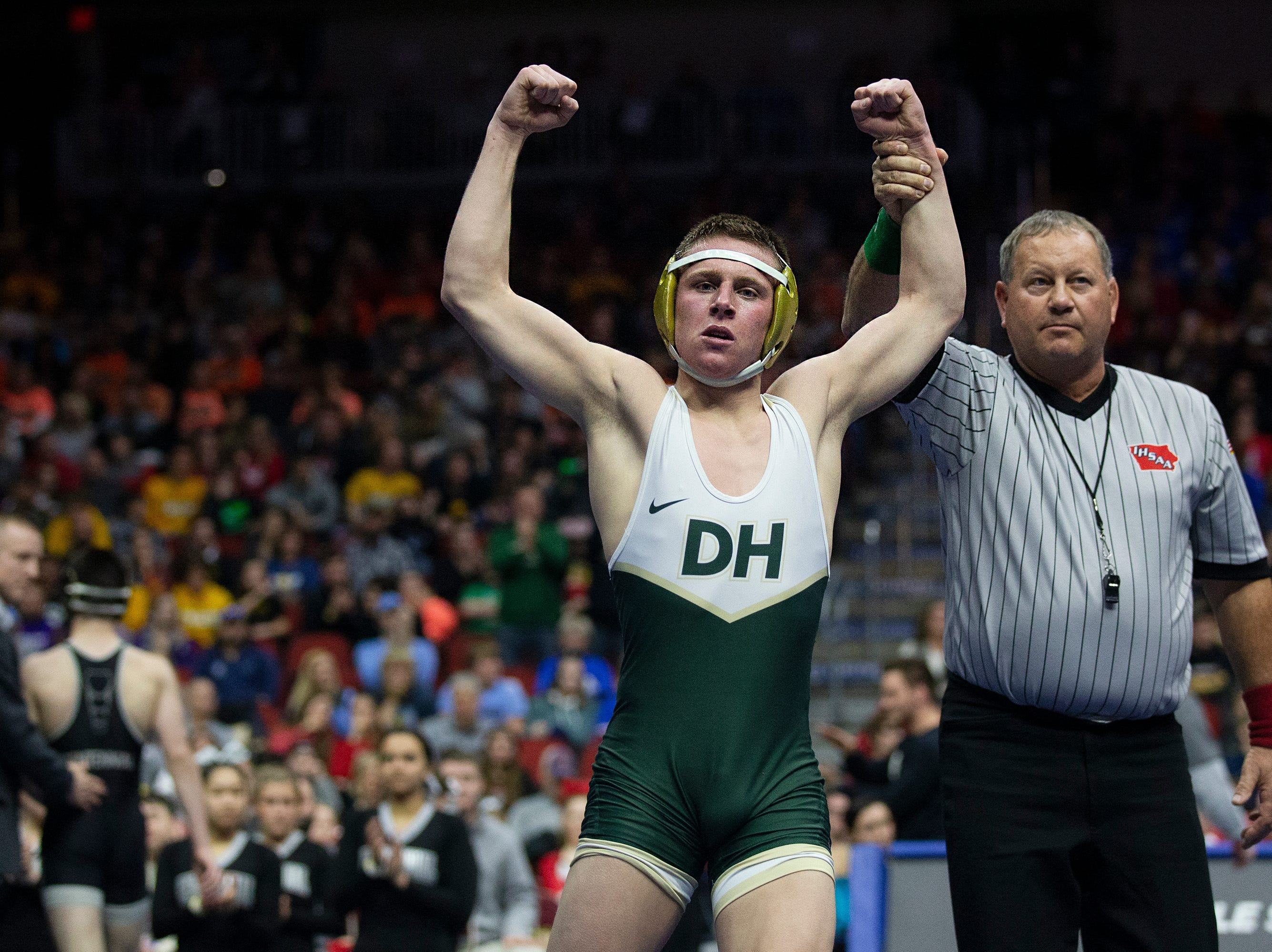 Dubuque Hempstead's Joe Pins wins the 132 pound Class 3A championship match against Ankeny Centennial's Ben Monroe during the Iowa high school state wrestling tournament on Saturday, Feb. 16, 2019, in Wells Fargo Arena.