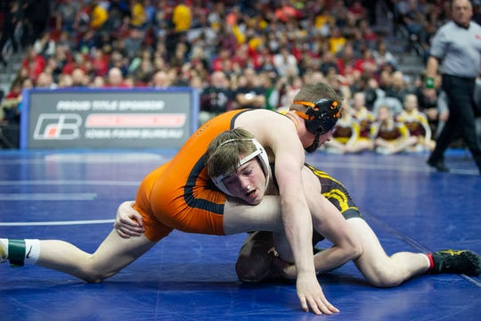 Ankeny's Caleb Rathjen wrestles West Des Moines Valley's Nick Oldham during the 126 pound class 3A championship match during the Iowa high school state wrestling tournament on Saturday, Feb. 16, 2019, in Wells Fargo Arena.