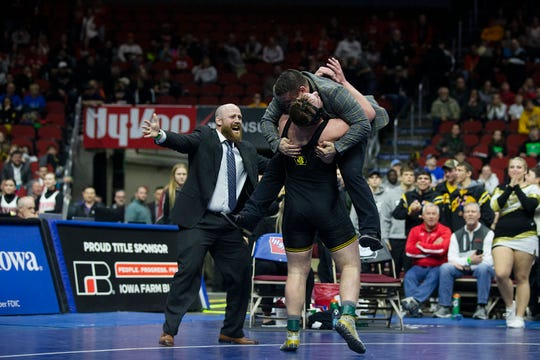 Waverly-Shell Rock's Andrew Snyder wraps coach Eric Whitcome in a hug after winning the Class 3A 285-pound state title in February. Whitcome was named the 2018-19 All-Iowa Coach of the Year, in part, for leading the Go-Hawks to their first traditional state team championship since 2011.