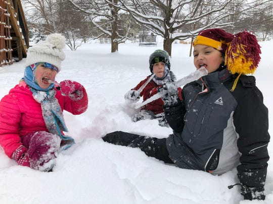 """It's the perfect day to be outside in the snow in #DSMUSA,"" Tiffany Tauscheck told the Register in a tweet with her #registersnowplay photo on Sunday, Feb. 17, 2019. Tauscheck's daughter Tenny, 5, and son Ty, 8, took a break from their snowplay to eat icicles with their Clive neighbor, Ethan, 8.  (Join the fun by Tweeting your best snow photos with the hashtag #registersnowplay)"