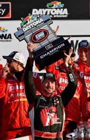 Feb 16, 2019; Daytona Beach, FL, USA; NASCAR Xfinity Series driver Michael Annett (1) celebrates after winning  the NASCAR Racing Experience 300 at Daytona International Speedway.