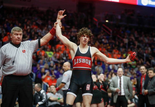 Lisbon senior Cobe Siebrecht celebrates after beating Underwood freshman Nick Hamilton for a Class 1A state championship win at 138 pounds on Saturday, Feb. 16, 2019, at Wells Fargo Arena in Des Moines.