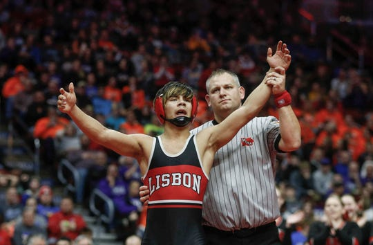 Lisbon freshman Robert Avila Jr., celebrates a state title win over Logan-Magnolia sophomore Briar Reisz in their Class 1A finals match at 126 pounds during the state wrestling championships on Saturday, Feb. 16, 2019, at Wells Fargo Arena in Des Moines.
