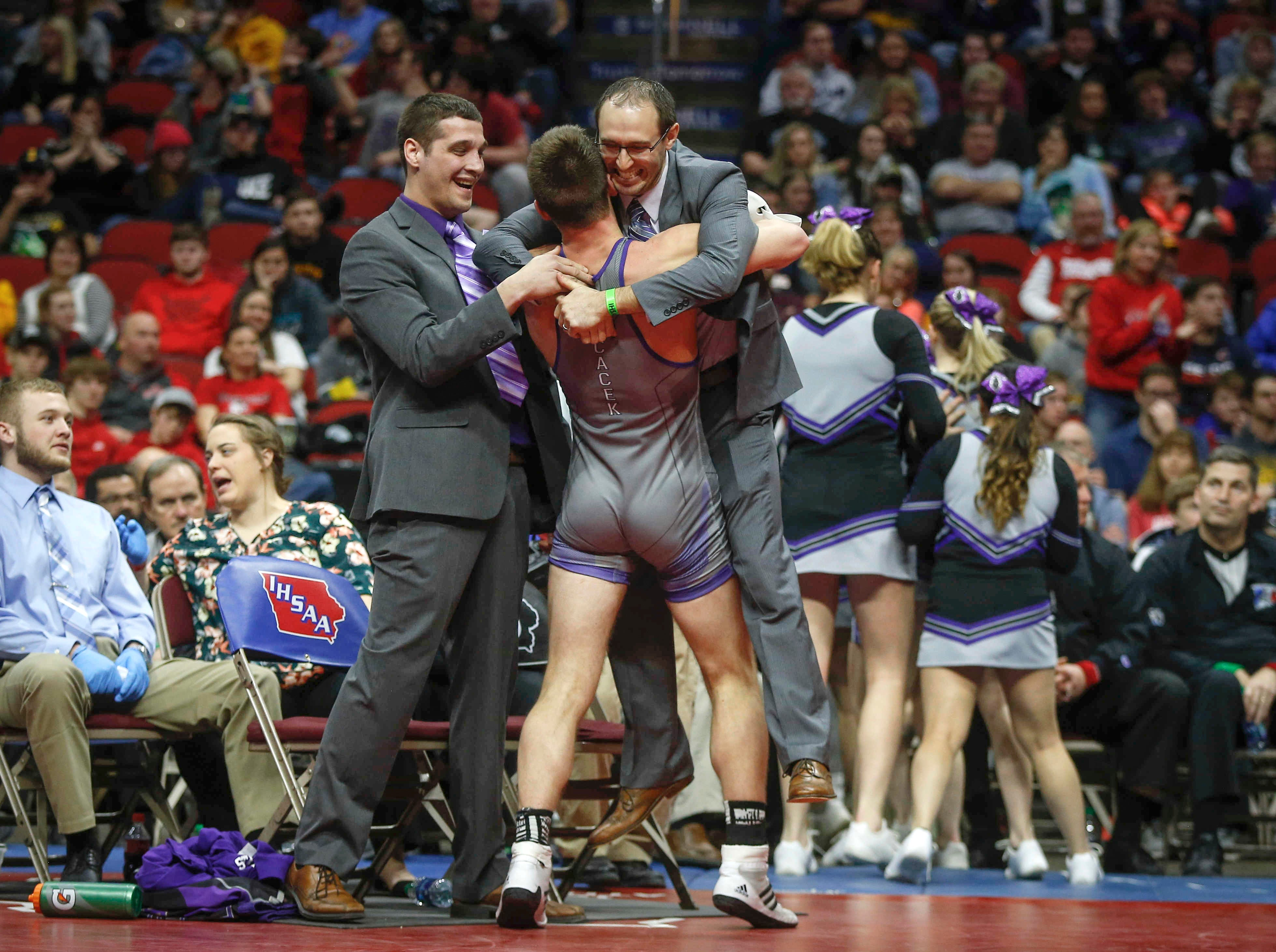 GTRA junior Treyton Cacek celebrates a Class 1A state title win with his coaches after beating Western Christian sophomore Tristan Mulder at 170 pounds on Saturday, Feb. 16, 2019, at Wells Fargo Arena in Des Moines.