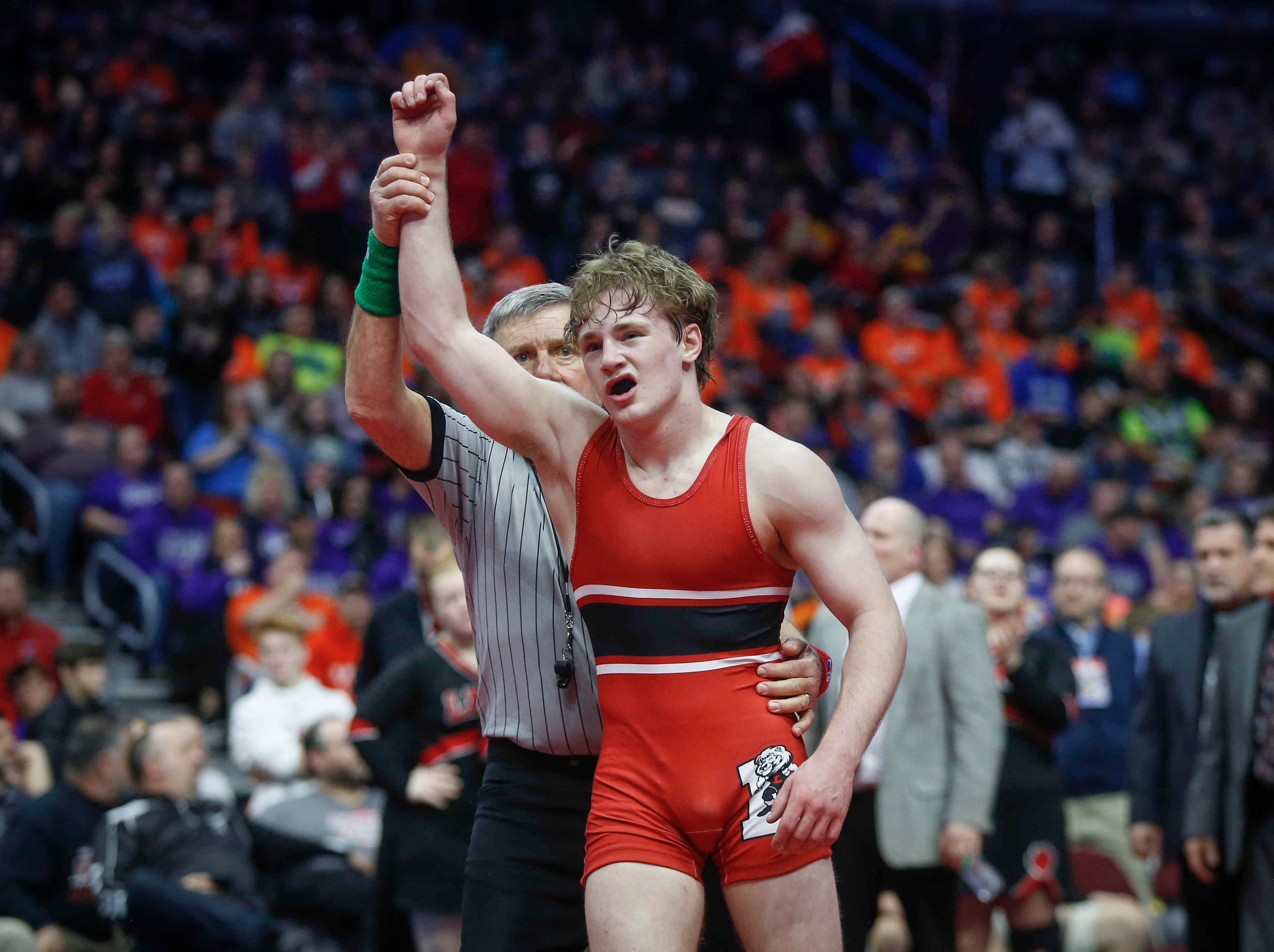 Lisbon junior Cael Happel celebrates after beating Underwood junior Logan James for a Class 1A state title win at 132 pounds during the state wrestling Class 1A championship on Saturday, Feb. 16, 2019, at Wells Fargo Arena in Des Moines.
