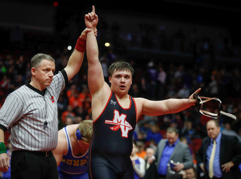 Missouri Valley senior Arron Olson celebrates a Class 1A state title win over Don Bosco senior Noah Pittman at 285 pounds on Saturday, Feb. 16, 2019, at Wells Fargo Arena in Des Moines.