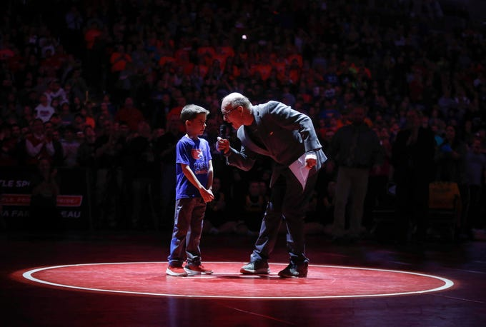 Iowa wrestling legend Dan Gable and 7-year-old Sebastiano Fidone helped kick off the 2019 Iowa high school state wrestling championships on Saturday, Feb. 16, 2019, at Wells Fargo Arena in Des Moines.