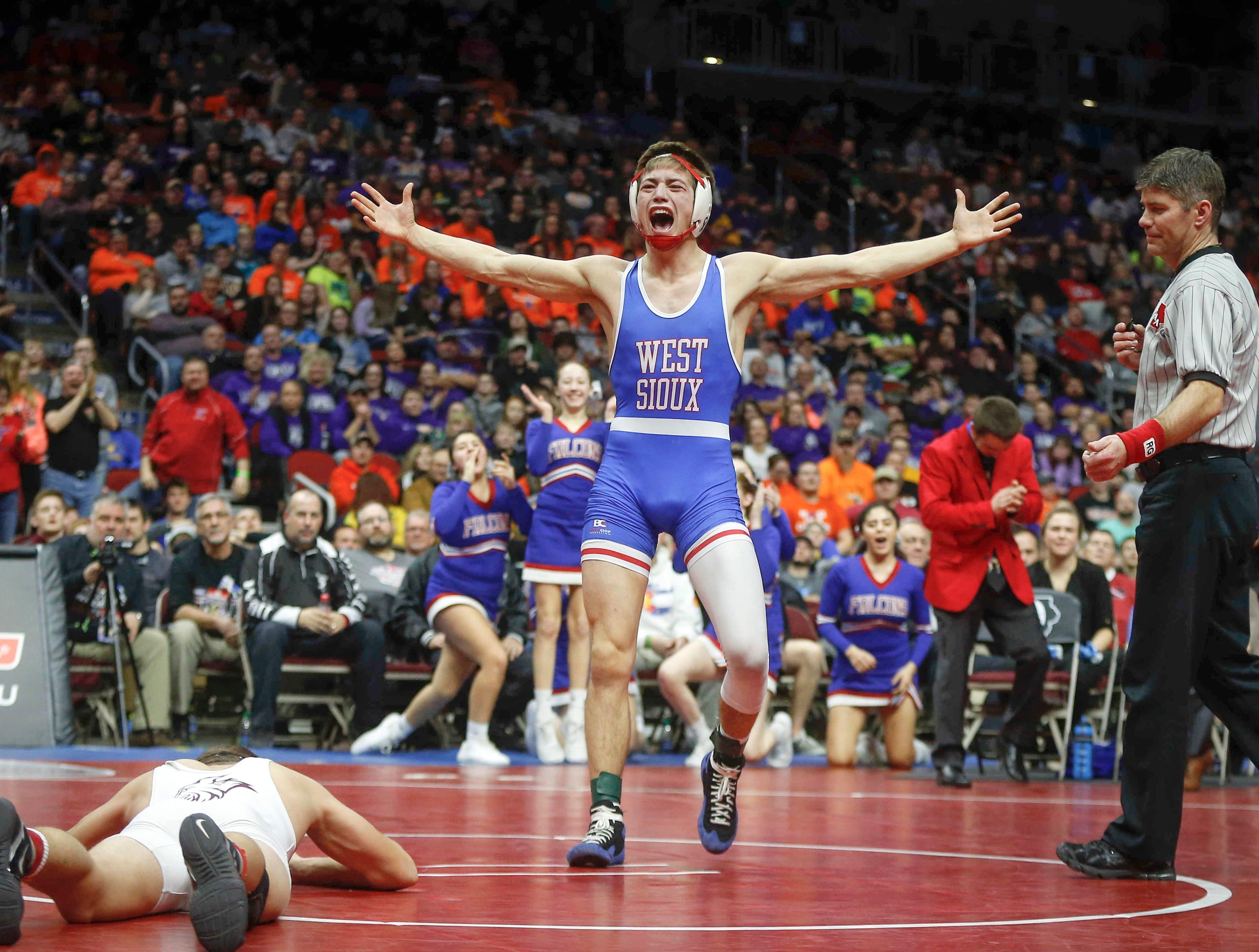 West Sioux senior Kory Van Oort celebrates after beating North Linn senior Brady Henderson in their match at 152 pounds during the state wrestling Class 1A championship on Saturday, Feb. 16, 2019, at Wells Fargo Arena in Des Moines.