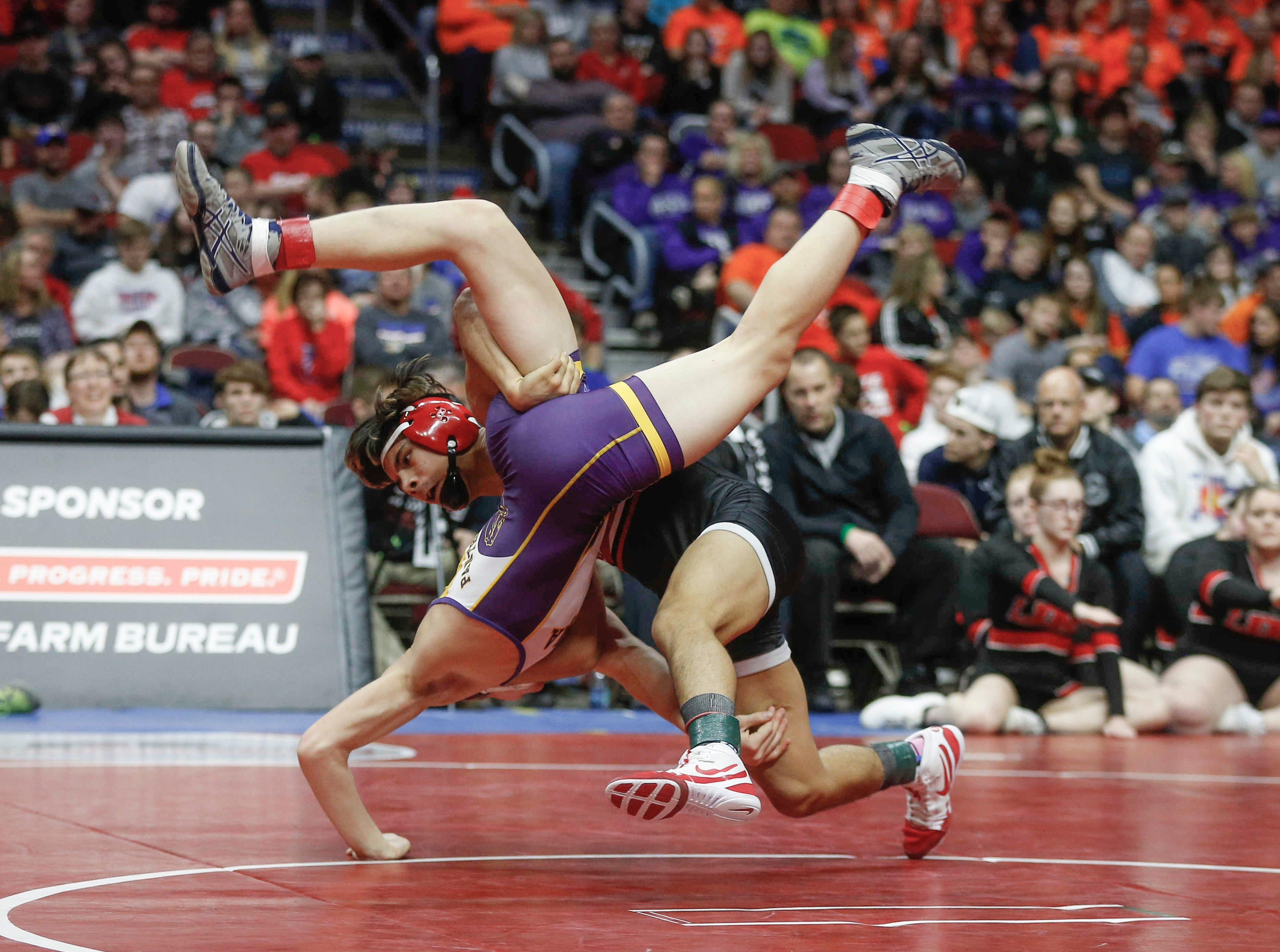 Lisbon freshman Robert Avila Jr. dumps Logan-Magnolia sophomore Briar Reisz in their Class 1A finals match at 126 pounds during the state wrestling championships on Saturday, Feb. 16, 2019, at Wells Fargo Arena in Des Moines.