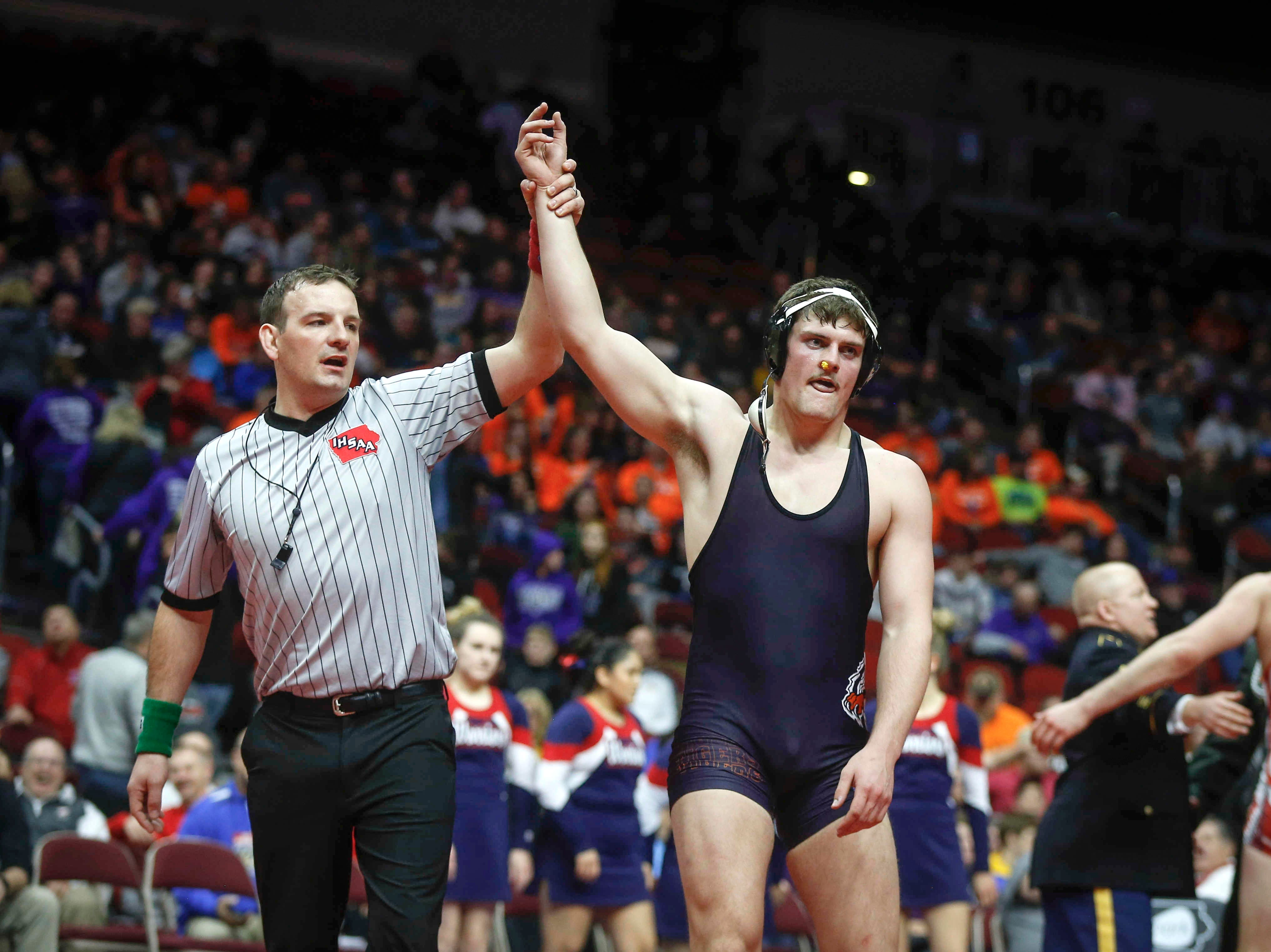 Iowa Valley senior Garet Sims celebrates after beating Alta-Auralia senior Nick Gaes for a Class 1A state title win at 220 pounds on Saturday, Feb. 16, 2019, at Wells Fargo Arena in Des Moines.