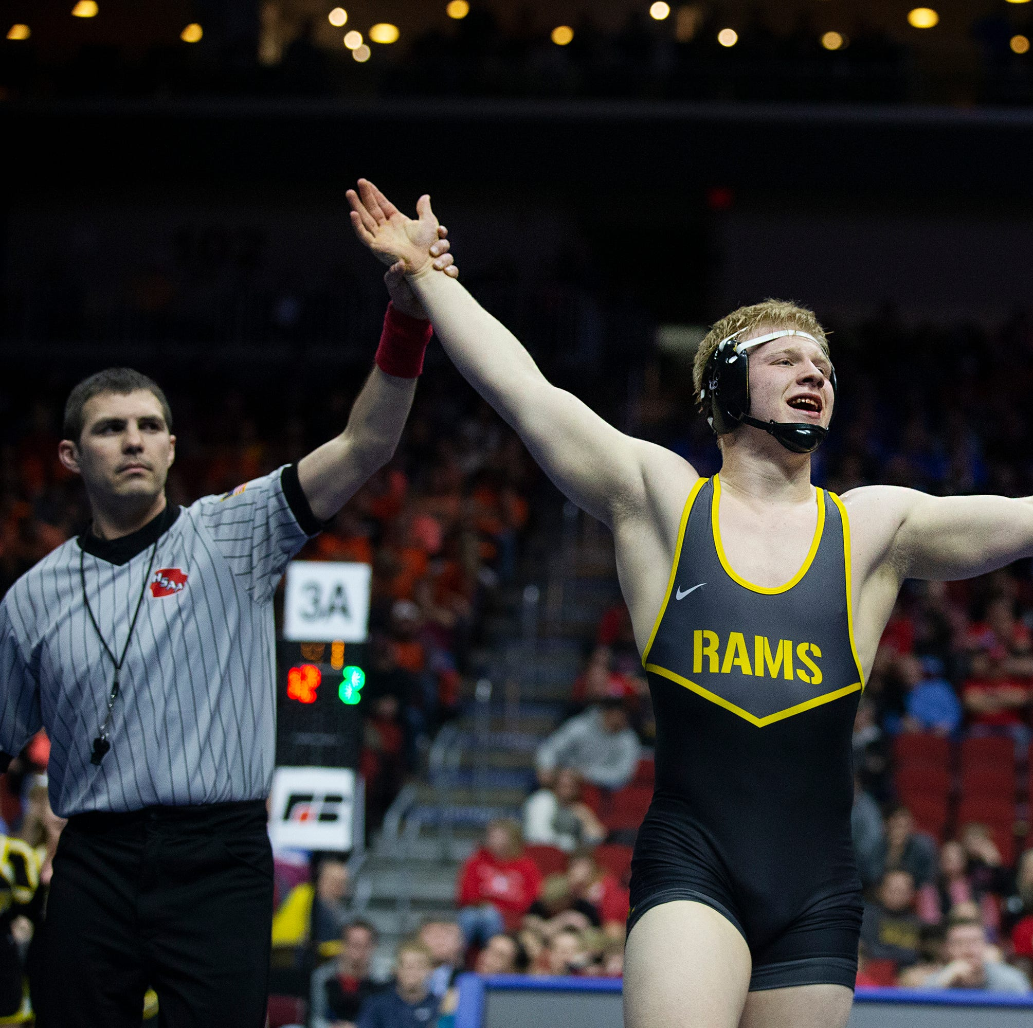 Southeast Polk wrestler celebrates state title by throwing his coach to the mat