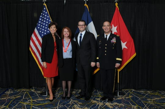 Katy Downes of Winterset, second from left, was appointed by Gov. Kim Reynolds as an honorary colonel in the Iowa State Militia in January. She is pictured with Reynolds, Lt. Gov. Adam Gregg and Major General Timothy E. Orr.
