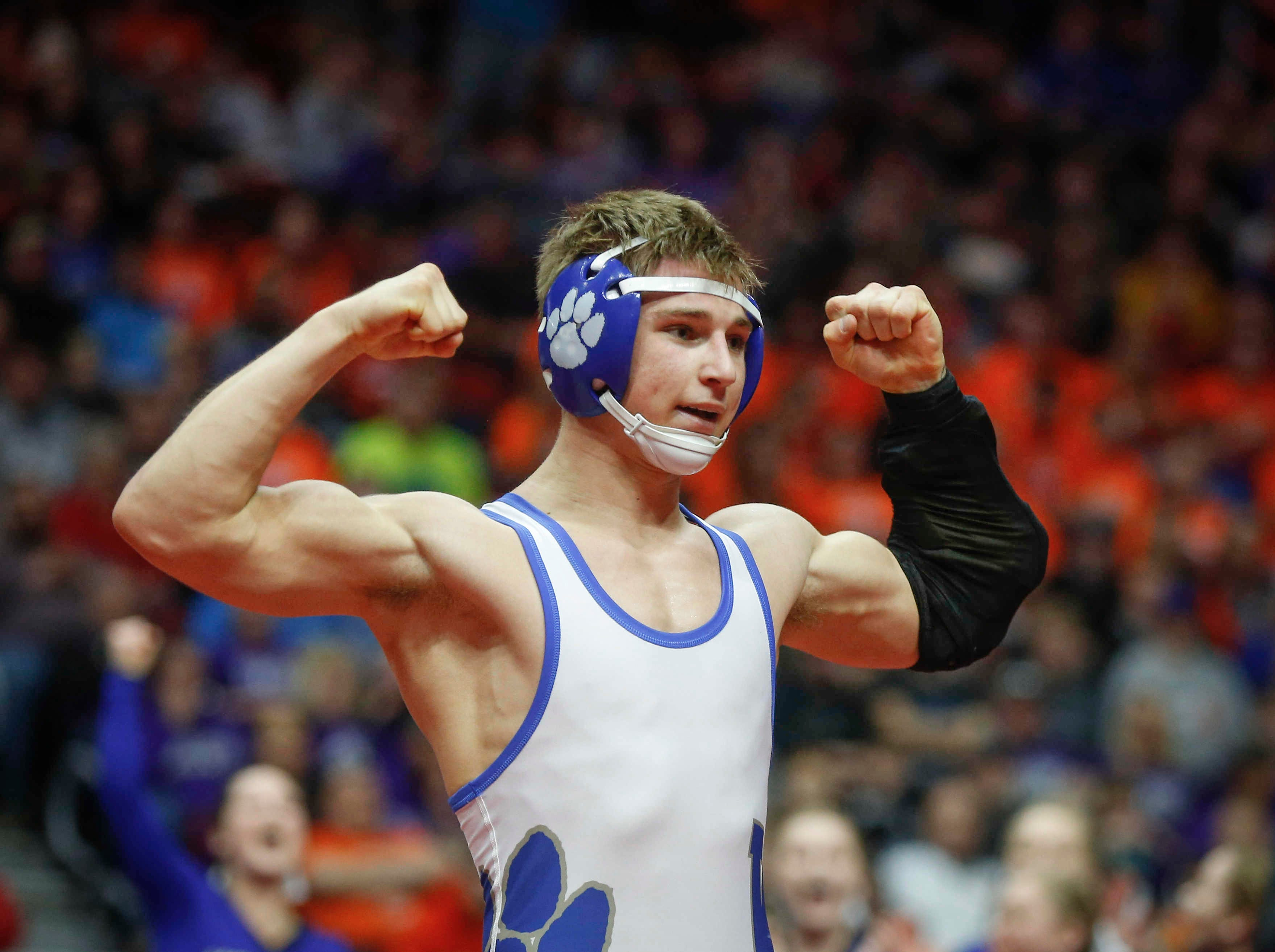 Woodbury Central junior Wade Mitchell celebrates after beating Emmetsburg senior Spencer Griffin for a Class 1A state title win at 145 pounds on Saturday, Feb. 16, 2019, at Wells Fargo Arena in Des Moines.